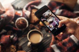 instagram photography blogging workshop concept. hand holding ph